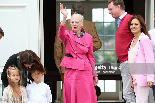 Queen Margrethe II of Denmark waves to the photographers at the annual summer photo call for The Danish Royal Family at Grasten Castle on July 15...