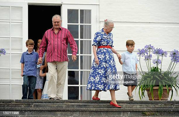 Queen Margrethe II Prince Consort Henrik of Denmark and Prince Christian and Prince Felix attend a photocall at Grasten Castle on August 1 2011 in...