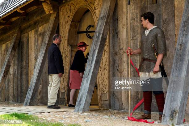 """Queen Margrethe of Denmark, after having cut the red ribbon, open the doors to the impressive Viking Hall at the """"Land of Legends"""" at Lejre open air..."""