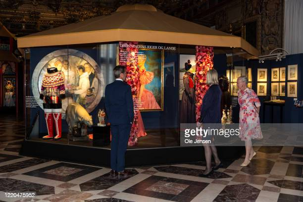 """Queen Margrethe of Denmark and Crown Prince Frederik seen at the exhibition opening of """"The Faces of the Queen"""" celebrating Queen Margrethe II of..."""