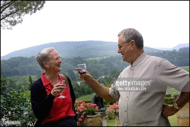 Queen Margrethe of Denmark and Henri de Monpezat in their castle of Caix In Luzech, France On August 08, 2002 - Tasting their owner wine.