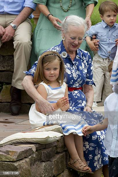 Queen Margrethe Of Denmark And Her Grandaughter Princess Isabella Attend A Photocall For The Danish Royal Family At Grasten Castle In Southern Denmark