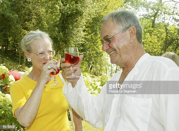 Queen Margrethe of Denmark and Prince Henrik drink wine in the garden of their Castle of Caix August 7 2003 in the village of Caix in southwestern...