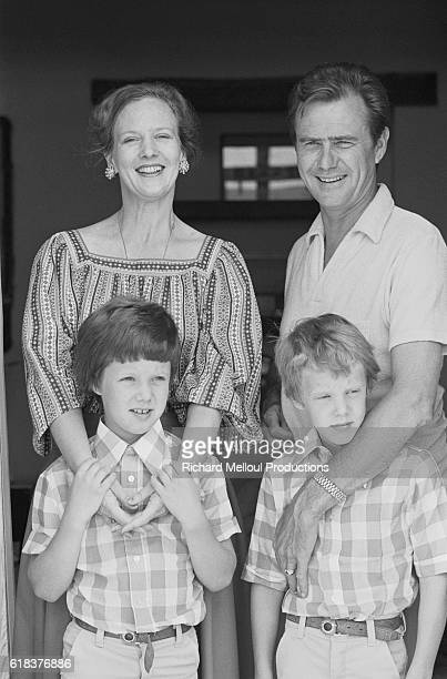 Queen Margrethe of Denmark and Prince Henrik stand behind their two sons Crown Prince Frederik and Prince Joachim shortly after their tenth wedding...