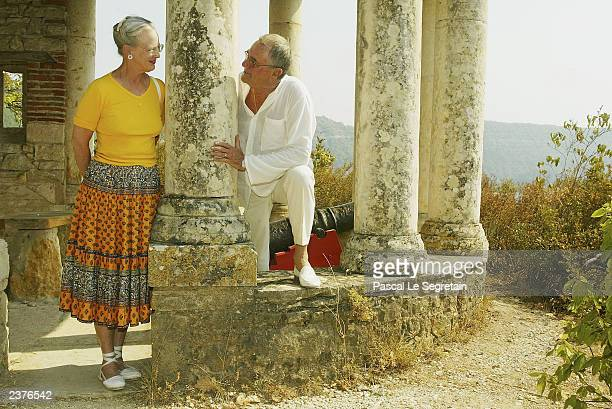 Queen Margrethe of Denmark and Prince Henrik stand in the grounds of their Castle of Caix August 7 2003 in the village of Caix in southwestern France...