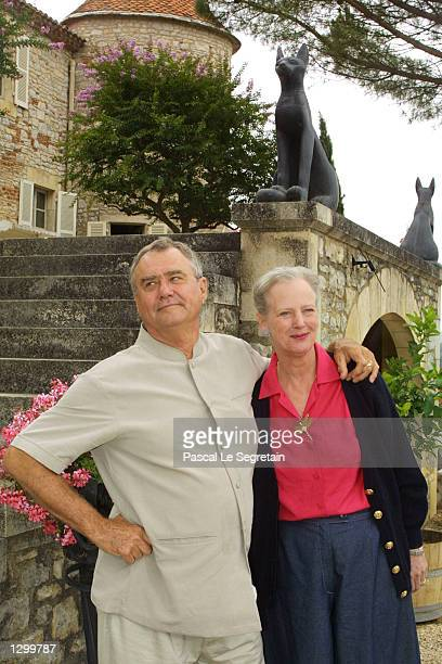 Queen Margrethe of Denmark and Prince Henrik stand on the grounds of their Castle of Caix August 8 2002 in the village of Caix in southwestern France...