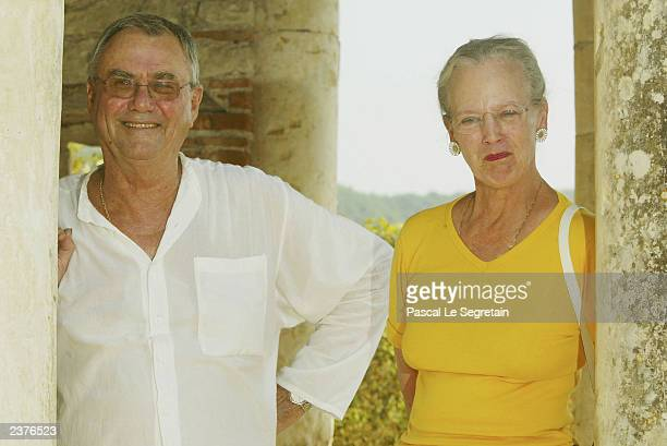 Queen Margrethe of Denmark and Prince Henrik stand on the grounds of their Castle of Caix August 7 2003 in the village of Caix in southwestern France...