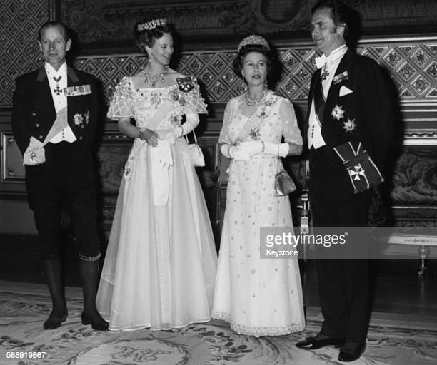 Queen Margrethe of Denmark and Queen Elizabeth II of Great Britain with their husbands Prince Hendrik and Prince Philip at a state banquet Windsor...