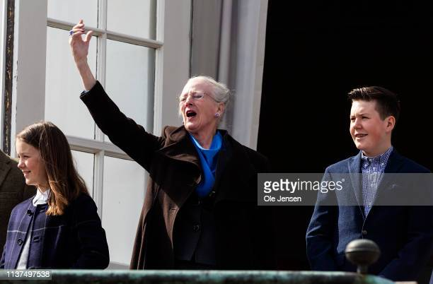 Queen Margrethe of Denmark appears together with Prince Christian and Princess Isabella at the veranda on Marselisborg Castle during changing of the...