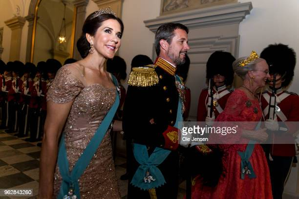 Queen Margrethe of Denmark as host for the evening leads Crown Prince Frederik and Crown Princess Mary to the Knights hall where the gala banquet on...