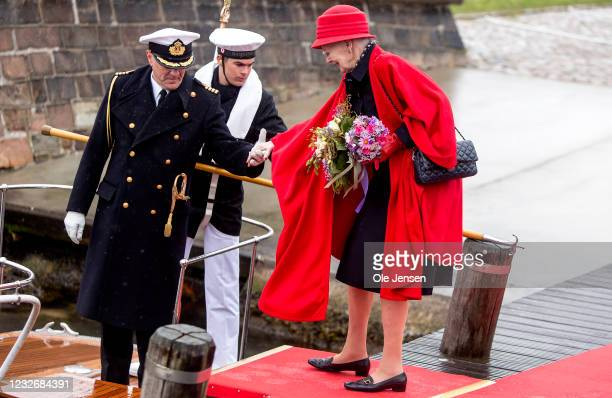 Queen Margrethe of Denmark embarks to the Royal ship, Dannebrog, on May 4, 2021 in Copenhagen, Denmark. Dannebrog lays for swing at anchor at...