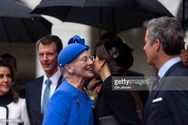 Queen Margrethe of Denmark greets Crown Princess Mary during the Royal family's arrival to Parliament where they attended the Prime Ministers opening...