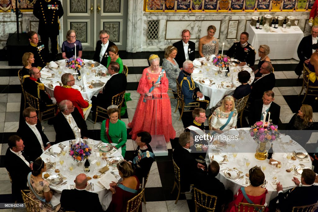 Queen Margrethe of Denmark (C) holds the birthday speech for Crown Prince Frederik of Denmark at the galla dinner in the Knights Hall on the occasion of the Crown Prince's 50th birthday at Christiansborg Palacel on May 26, 2018 in Copenhagen, Denmark. Some 350 guest participated in the event