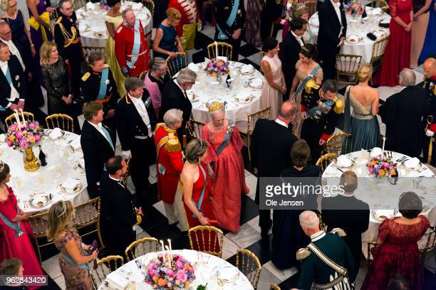 Queen Margrethe of Denmark is lead to her table at The Knights hall where she hoost the Galla Dinner for Crown Prince Frederik on the occasion of his...