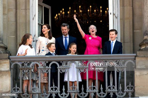 Queen Margrethe of Denmark leads the cheering for Crown Prince Frederik of Denmark /L 3rd on the Amalienborg Palace square on the occasion of his...