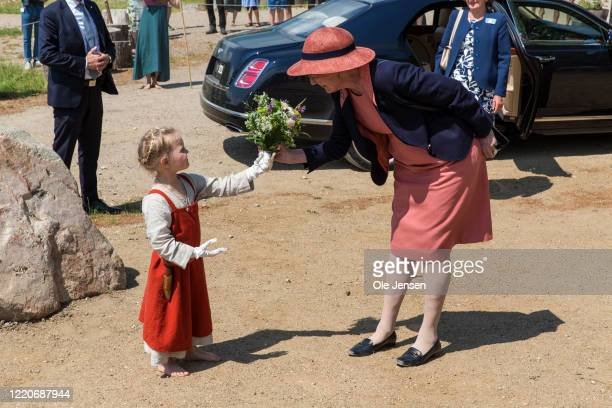 """Queen Margrethe of Denmark receives flowers at arrival to the opening of the world largest Viking Hall at the """"Land of Legends"""" Lejre open air museum..."""