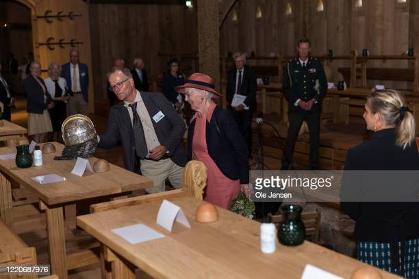 """Queen Margrethe of Denmark seen at the inauguration of the great Viking Hall at the """"Land of Legends"""" open air museum, where she is shown a warriors..."""