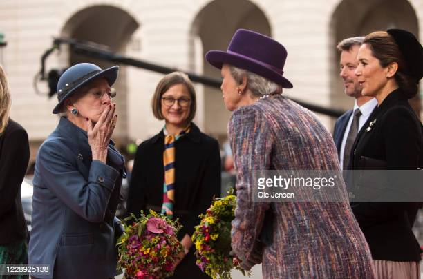 Queen Margrethe of Denmark sends a kiss to her sister, Princess Benedikte, while Crown Princess Mary and Crown Prince Frederik look on during the...