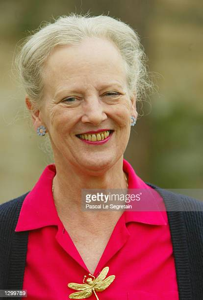 Queen Margrethe of Denmark stands on the grounds of her Castle of Caix August 8 2002 in the village of Caix in southwestern France The queen will...