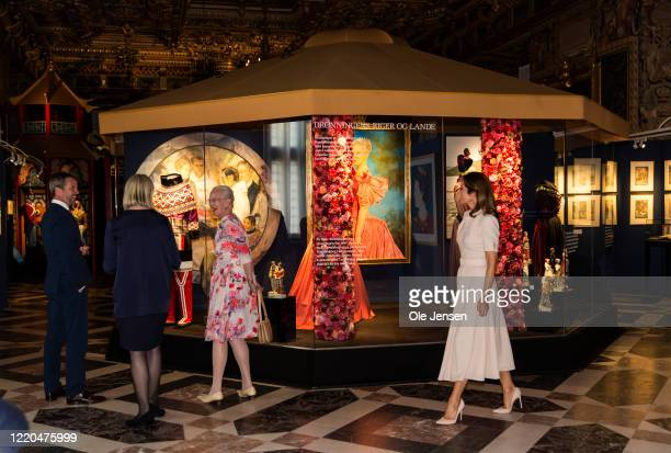 """Queen Margrethe of Denmark together with Crown Princess Mary and Crown Prince Frederik seen at the exhibition opening of """"The Faces of the Queen""""..."""