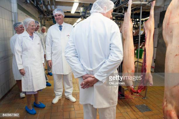 Queen Margrethe of Denmark visits Danish Crown visits Danish Crown pig slaughterhouse during her first day at Borholm in the Baltic Sea on August 30...
