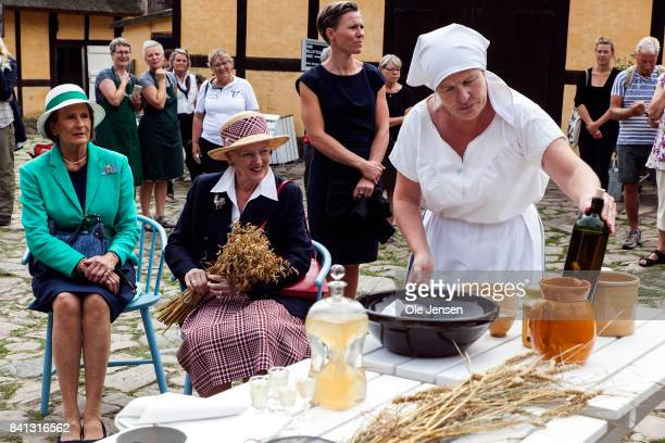 Queen Margrethe of Denmark visits the farm museum 'Gaarden' during her second day visit to the island of Bornholm in the Baltic Sea on August 31 2017...