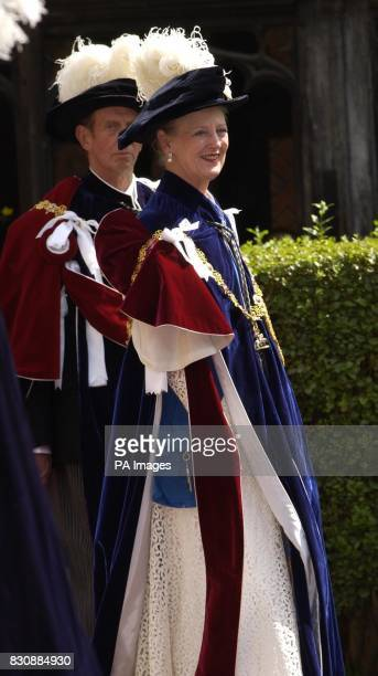 Queen Margrethe of Denmark walks in procession to St George's Chapel Windsor to attend the Order of the Garter ceremony where she installed her...