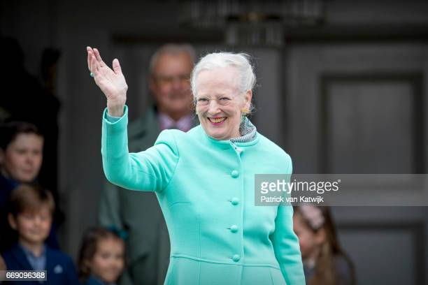 Queen Margrethe of Denmark waves during her 77th birthday celebrations at Marselisborg Palace on April 16 2017 in Aarhus Denmark