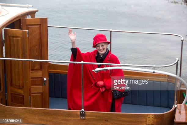 Queen Margrethe of Denmark waves during the official embarkment to the Royal ship, Dannebrog, on May 4, 2021 in Copenhagen, Denmark. Dannebrog lays...