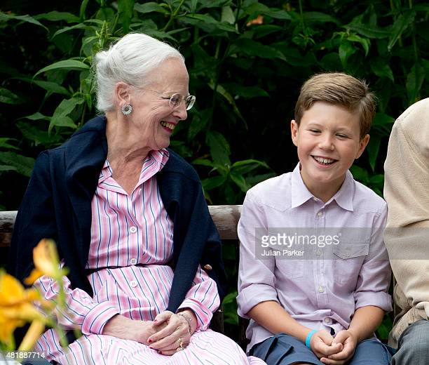 Queen Margrethe of Denmark with her grandchild Prince Christian of Denmark attend the annual summer Photocall for The Danish Royal Family at Grasten...
