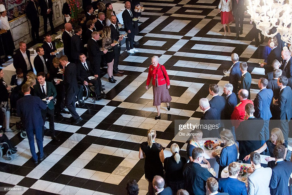 Queen Margrethe walks to the rostrum as she hosts a reception for the Danish Olympic and Para-Olympic Teams at Christiansborg on October 14, 2016 in Copenhagen, Denmark.