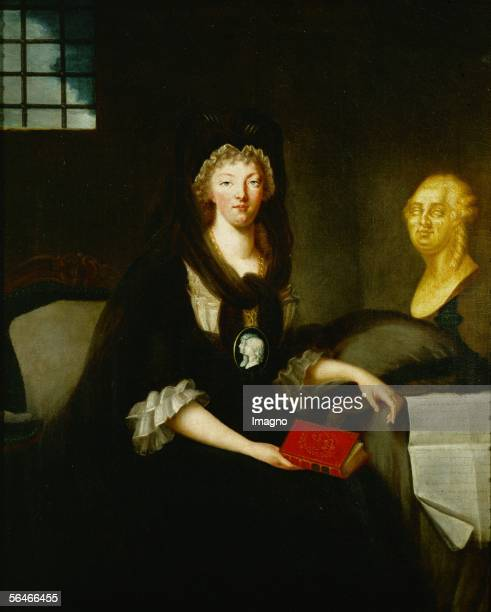 Queen Marie Antoinette imprisoned in the Conciergerie The Queen in deep mourning for her husband wears a medallion with the portraits of her two...