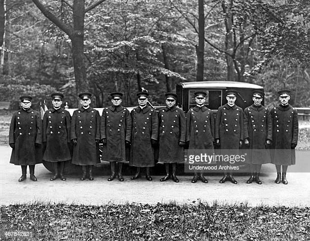 Queen Marie of Romania has a squadron of chauffeurs at her beck and call during her visit, October 19, 1926. The limousine is a 1926 Packard with a...