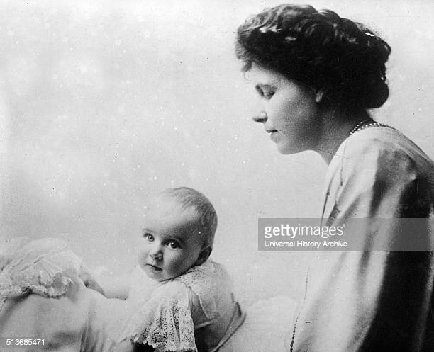 Queen Marie of Romania , who was married to Ferdinand of Romania and later served as Queen consort of Romania from 1914 to 1927. The baby is Princess...