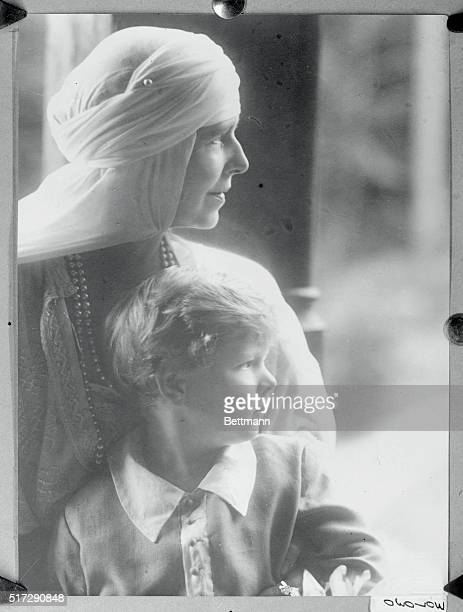 Queen Marie of Rumania with her grandson Prince Michael posing for the Juliet the court photographer at the Royal Palace at Sinaia.