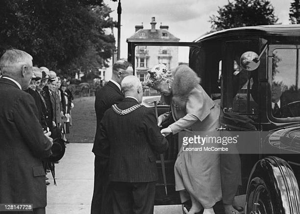 Queen Mary arrives at a youth rally in Gloucester, July 1943. Original publication: Picture Post - 1477 - Queen Mary Attends A Youth Rally In...