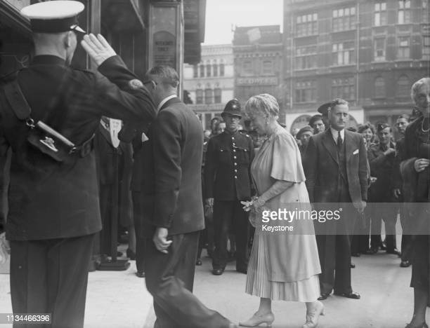 Queen Mary arriving at the Odeon cinema, Leicester Square, London, 11th August 1945. The Queen saw the films 'It's a Pleasure!', starring Sonja Henie...