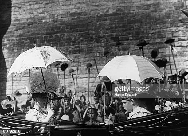 Queen Mary in a carriage with her son Edward at his investiture as the Prince Of Wales in Caernarfon