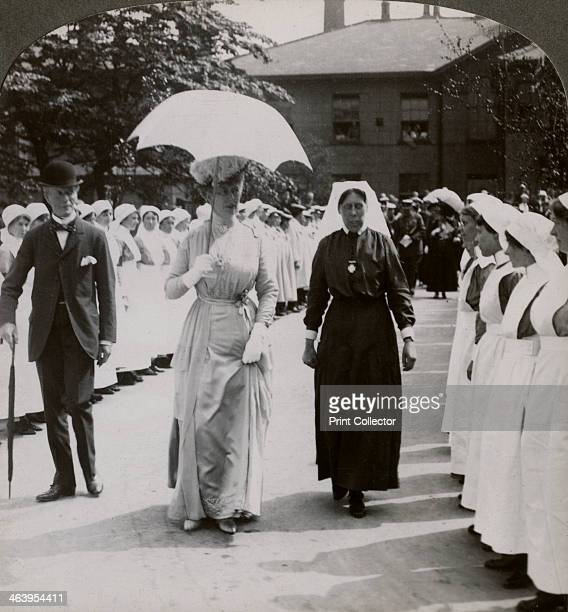 Queen Mary visiting the Royal Naval Hospital, Hull, Humberside, World War I, 1914-1918. The Queen walking through a guard of honour of nurses....