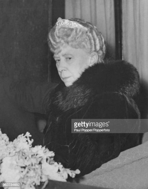 Queen Mary watching a performance of Emile Littler's pantomime 'Little Miss Muffet' from the Royal Box at the London Casino 20th December 1949 She is...