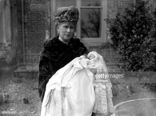 Queen Mary with her baby grandson, George Lascelles, later to be the 7th Earl of Harewood, the son of Mary, the Princess Royal, at his Christening in...