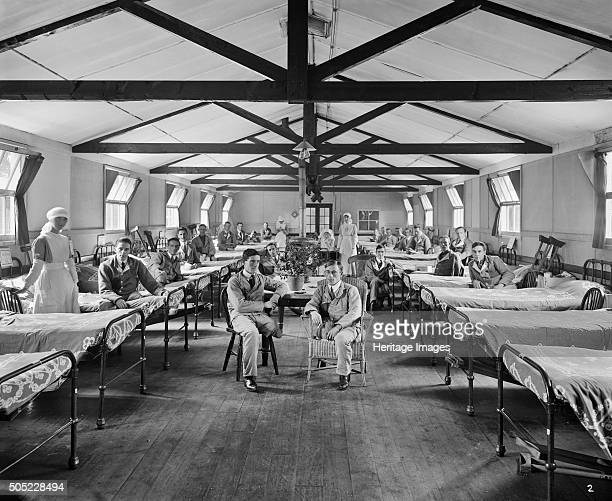 Queen Mary's Hospital Roehampton London January 1918 Ward 2 in Shanghai Hut No 3 at showing nurses and wounded servicemen with missing limbs wearing...
