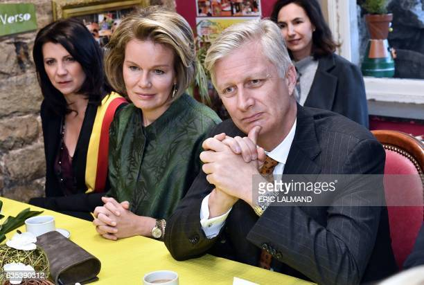 Queen Mathilde and King Philippe of Belgium sit as they visit a nonprofit association TeleService on February 15 2017 in Verviers / AFP / BELGA AND...