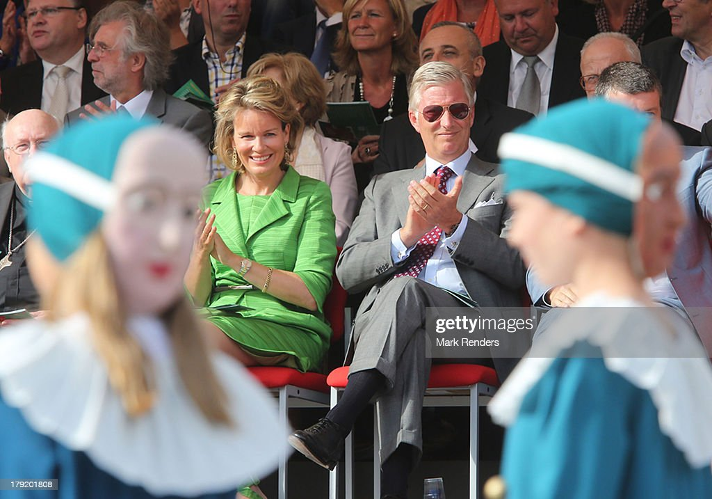 Queen Mathilde and King Philippe of Belgium watch during the Hanswijck's Calvade on September 1, 2013 in Mechelen, Belgium.