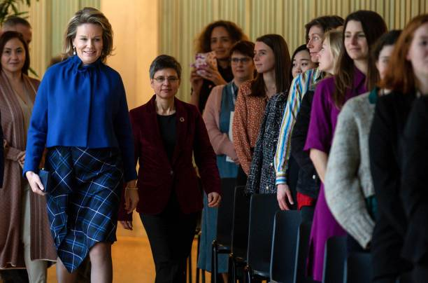 Queen Mathilde of Belgium and Antwerp province governor Cathy Berx walk during a royal visit to an event organised by Antwerp Management School...