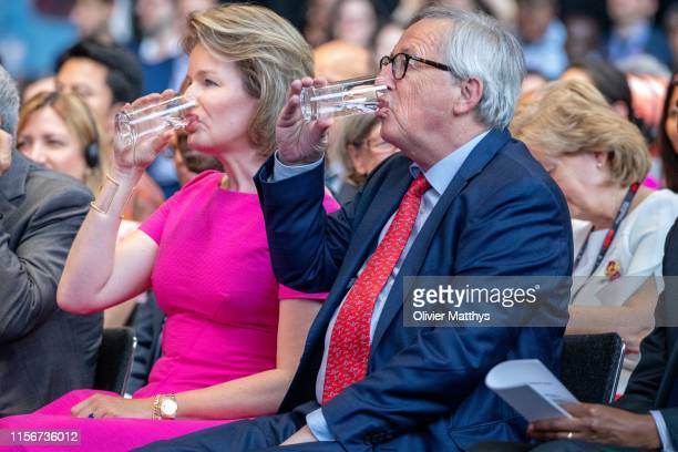 Queen Mathilde of Belgium and European Commission Chairman JeanClaude Juncker have a glass of water during the opening session of the European...