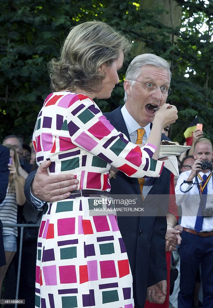 Queen Mathilde of Belgium and King Philippe - Filip of Belgium taste pie during a Royal Visit to the 'Fete au parc - Feest in het Park' celebrations on the occasion of Belgium's National Day in the Brussels Warandepark, on July 2015. **Belgium Out**