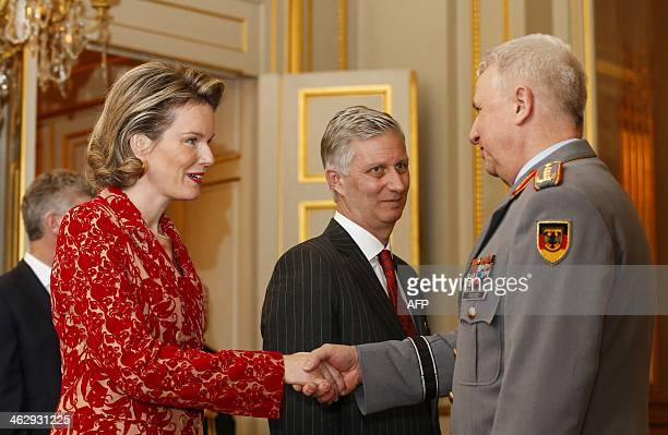 Queen Mathilde of Belgium and King Philippe greet General Werner Freers Chief of Staff of Supreme Headquarters Allied Powers Europe during a...