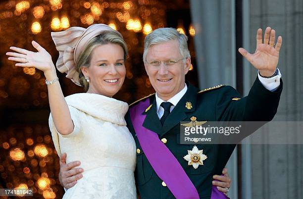 Queen Mathilde of Belgium and King Philippe of Belgium greet the audience from the balcony of the Royal Palace during the Abdication Of King Albert...