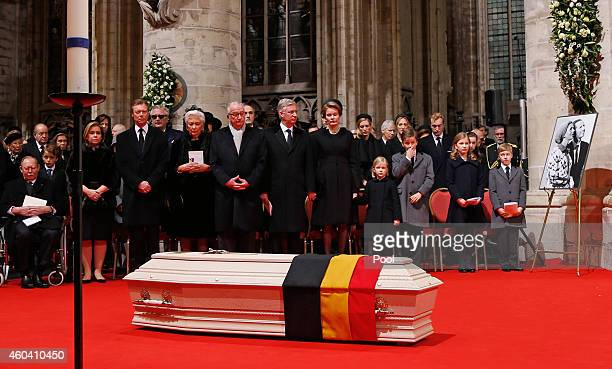 Queen Mathilde of Belgium and King Philippe of Belgium look on alongside members of their famly during the funeral of Queen Fabiola of Belgium is...